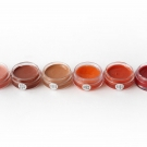 e.l.f. Essential Lip Balm Tint in Pink Princess, Rosy Rocker, Nude, Peach, Grapefruit, and Berry.