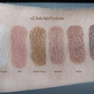 Foiled swatches of the e.l.f. Studio Baked Eyeshadow under direct sunlight: Moonlight Serenade, Pixie, Bronzed Beauty, Enchanted, Toasted, Bark