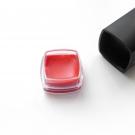 The plastic colored base of the e.l.f. Studio Moisturizing Lipstick has a removable containing a lip color pot.