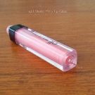 The tube of the e.l.f. Studio Minty Lip Gloss magnifies the actual contents.