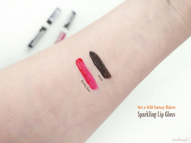 Swatches of the Wet n Wild Fantasy Makers Sparkling Lip Gloss in Bleeding Heart and Wicked