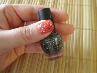 e.l.f. Nail Polish swatch in Chic Confetti over Red Hot