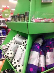 e.l.f. Nail Polish & Super Glossy Lip Shines in a Target stocking stuffer display in women's loungewear.